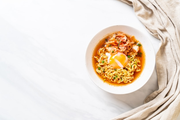 Korean instant noodles with kimchi and egg Premium Photo
