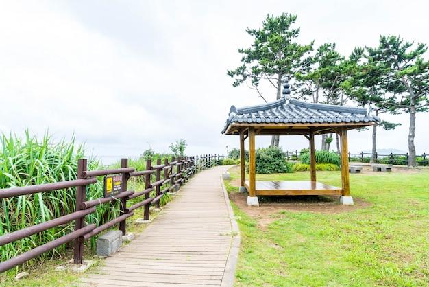 Korean pavillian at jeju-do oedolgae rock  park in jeju island Premium Photo