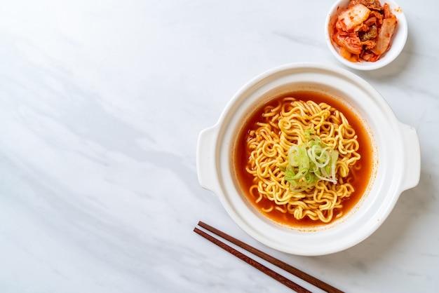 Korean spicy instant noodles with kimchi Premium Photo