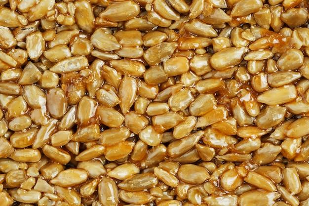 Kozinaki from golden, roasted sunflower seeds. macro shooting, Premium Photo