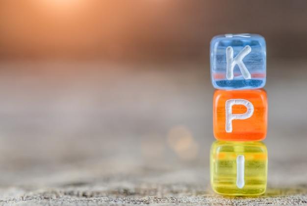 Kpi - key performance indicator on table background. Premium Photo