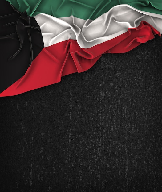 Kuwait flag vintage on a grunge black chalkboard with space for text Premium Photo