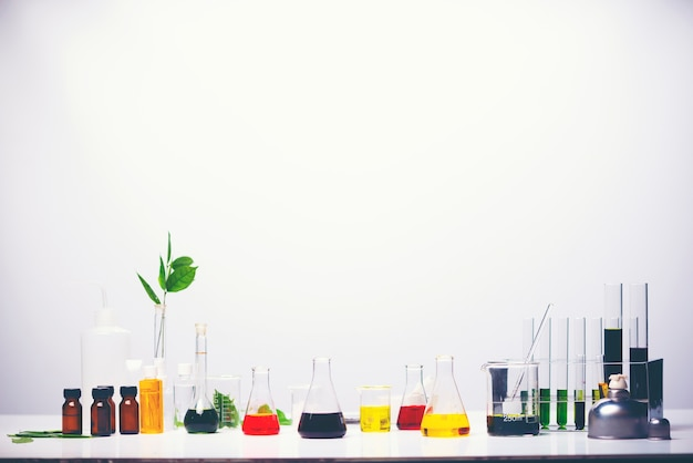 Lab equipment, glassware kit filled with various colored liquids and gels Premium Photo