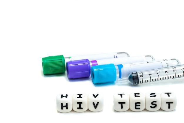 Laboratory test tubes and alphabet letters Premium Photo