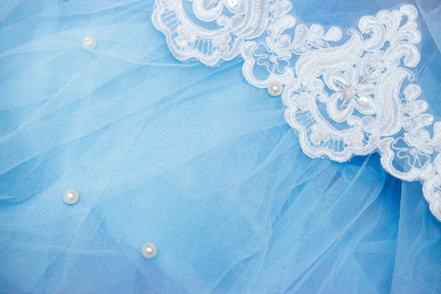 Lace on blue tulle with beads. sewing a wedding dress. wedding concept Premium Photo