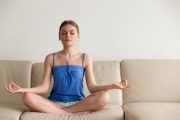 Lady doing yoga exercises at home in morning Free Photo