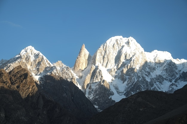Lady finger and ultar sar mountain peaks lit by morning sunlight