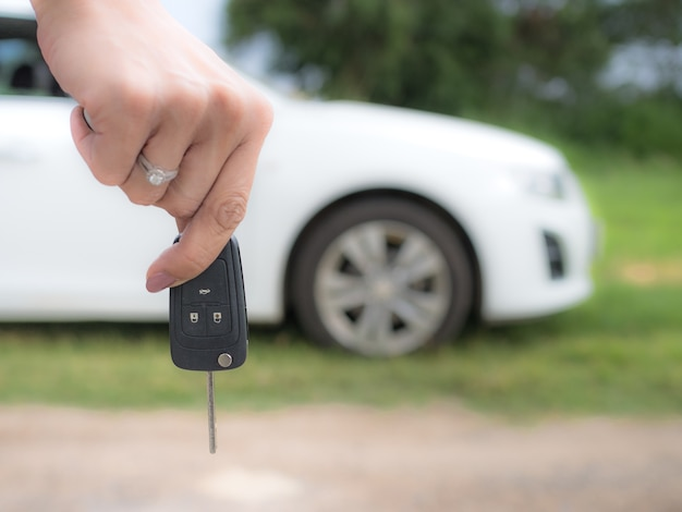 Lady Hand Holds Car Key For Your Own Control And Life Style Photo