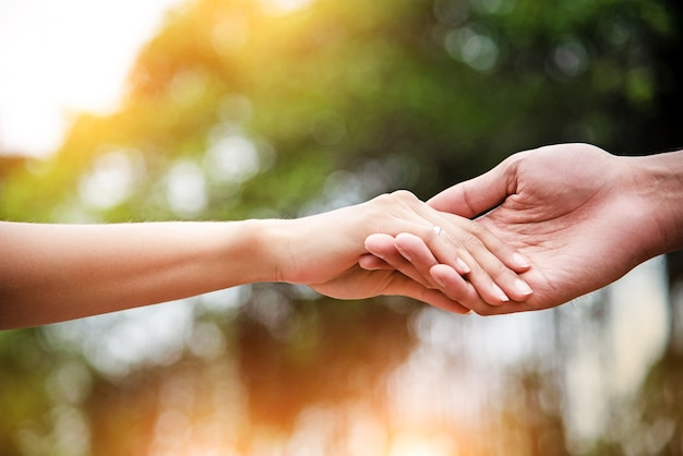 The lady hand touch on hand of husband, love hand sign, for trust and care Premium Photo