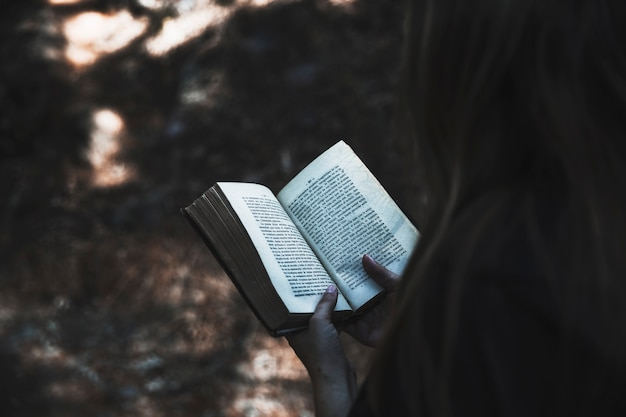 Lady's hands holding book Free Photo