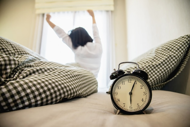 Lady wake up stretch oneself lazily for fresh morning Free Photo