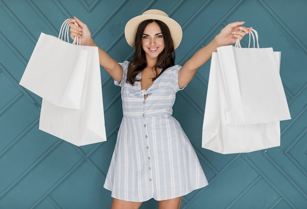 Lady with dress picking up the shopping nets Free Photo