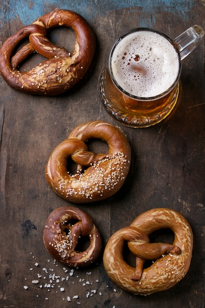 Lager beer with pretzels Premium Photo