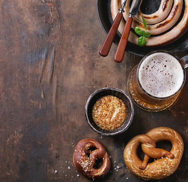 Lager beer with sausage and pretzels Premium Photo