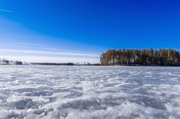 The lake is ice-covered winter day Premium Photo