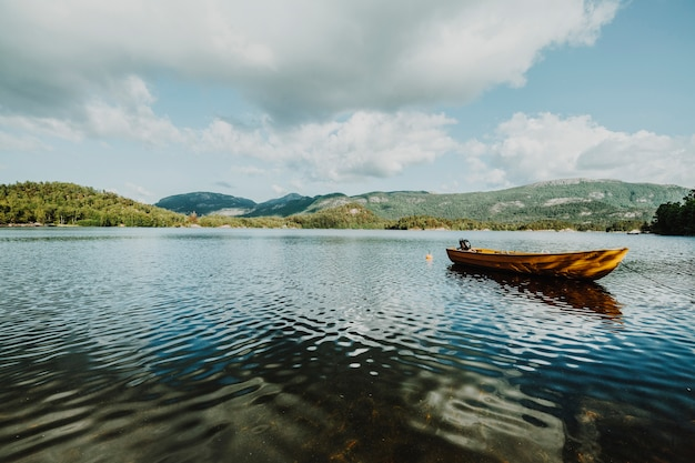 Lake surrounded by rocky landscape Free Photo