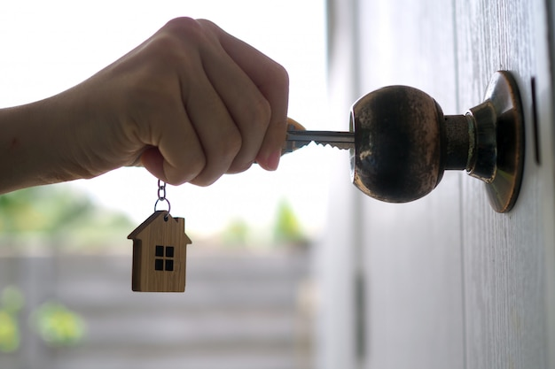 Landlord unlocks the house key for new home Premium Photo