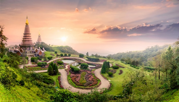 Landmark pagoda in doi inthanon with mist fog during sunset timeat chiang mai, thailand Premium Photo