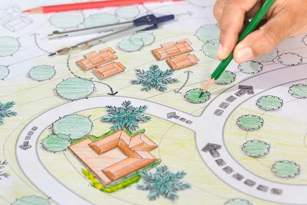 Landscape architect designs blueprints for resort. Premium Photo