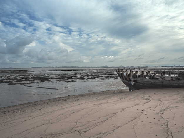 Landscape of beaches with sea and boat crashes Premium Photo