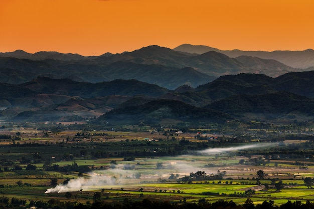 Landscape in chiang mai northern of thailand with farmland and mountains background Premium Photo