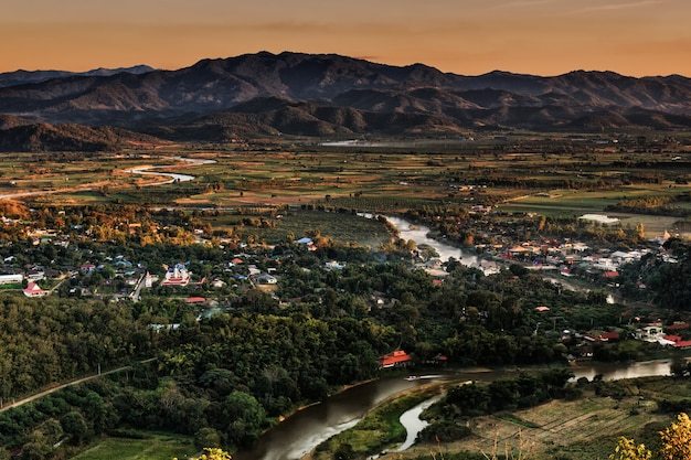 Landscape in chiang mai northern of thailand with kok river and moutain background Premium Photo