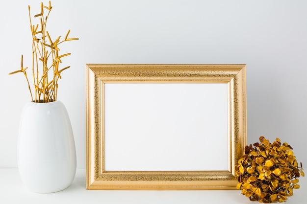 Landscape gold frame mockup with golden decor Premium Photo