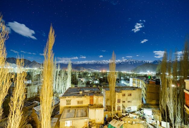 Landscape image of leh city with mountains view and stars in the sky at night Premium Photo