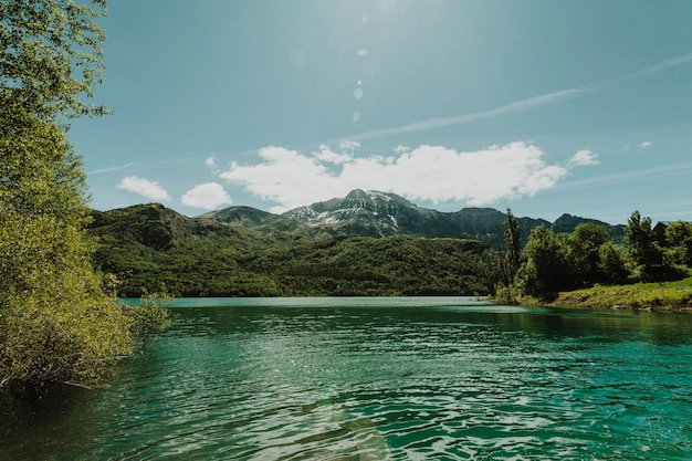 Landscape of a lake surrounded by mountains Free Photo