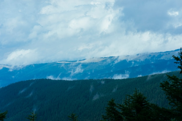 Landscape of layered mountain in the mist blue sky with clouds Free Photo