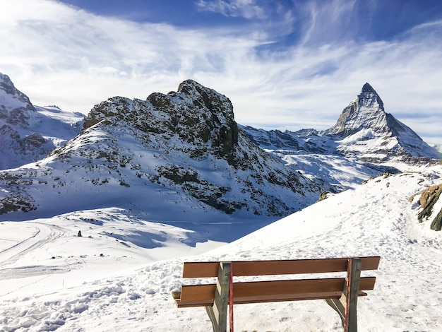 Landscape and nature of mountain matterhorn   from wood chair view in the morning with blue sky at zermatt, switzerland. Premium Photo