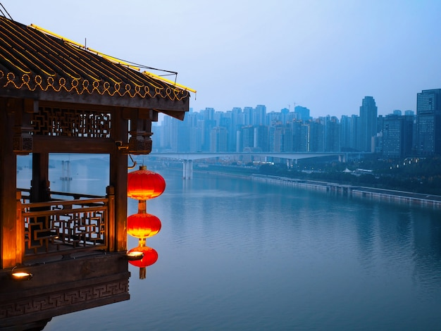 Landscape old and mordern buildings of downtown near water at chongqing, china. Premium Photo