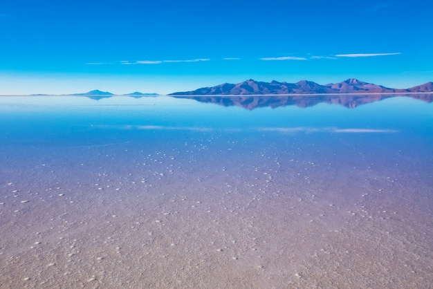 Landscape of salar de uyuni in bolivia covered with water, salt flat desert and sky reflections Premium Photo