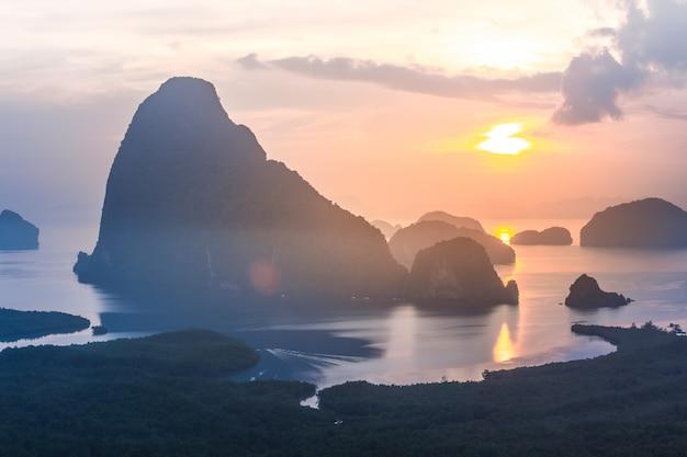 Landscape of sunrise at  limestone karsts in phang-nga bay at sunrise. Premium Photo