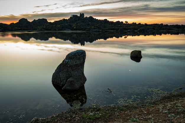 Landscape at sunrise in the natural area of barruecos. extremadura. spain. Premium Photo
