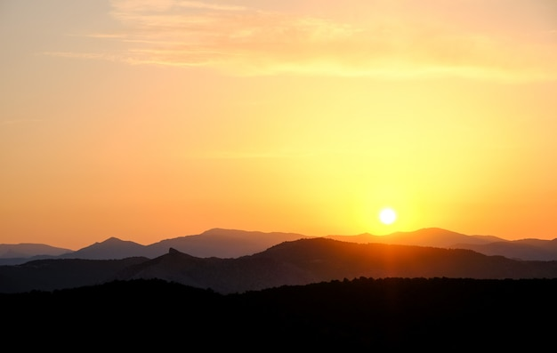 Landscape, sunset in the sky against the mountains, mountain ranges during sunset Premium Photo