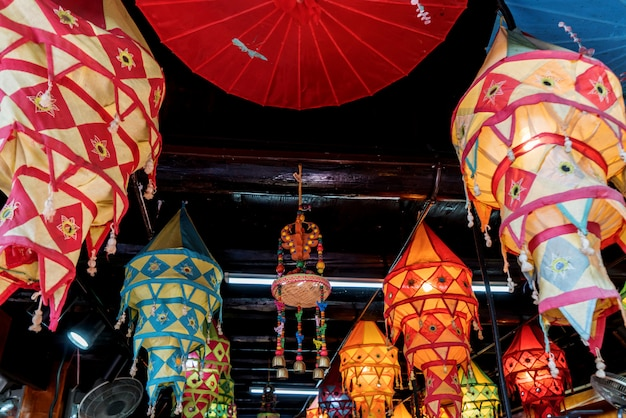 Lanterns of all colors hang on the roof Premium Photo