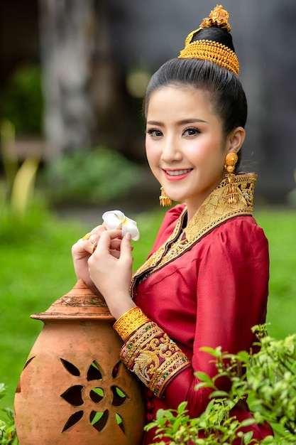 Premium Photo | Lao girl face in traditional dress with