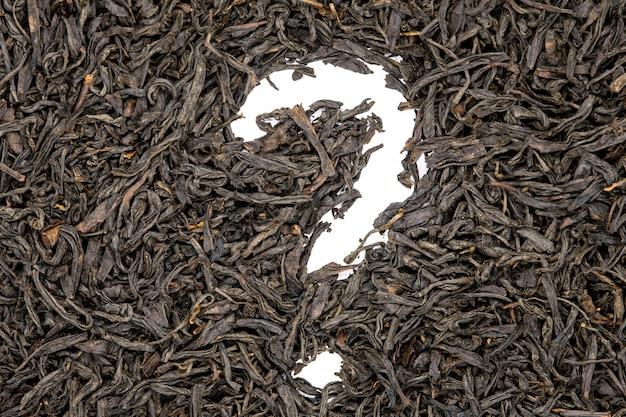Lapsang souchong tea, question mark shaped, close up  Photo