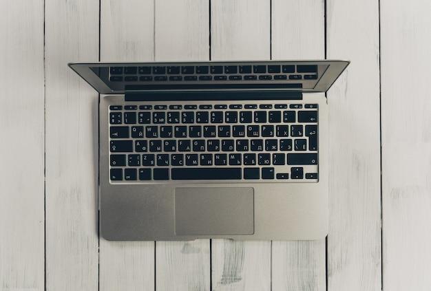 Laptop computer on a wooden desk, top view copy space Premium Photo