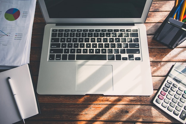 Laptop on the desk of business stylists vintage hipster. Premium Photo
