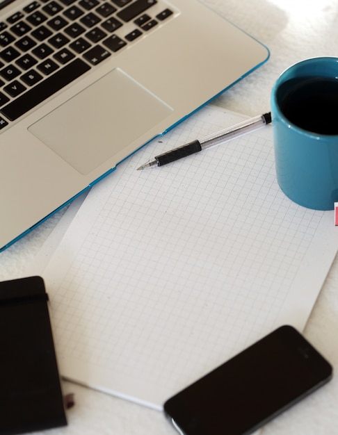 Laptop, mug and notepad Free Photo