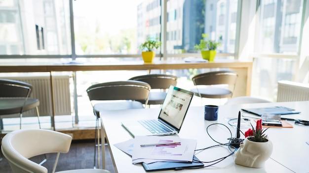 Laptop on desk in office Free Photo