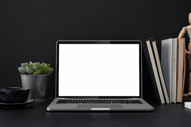 Laptop screen isolated on a desk in office Premium Photo