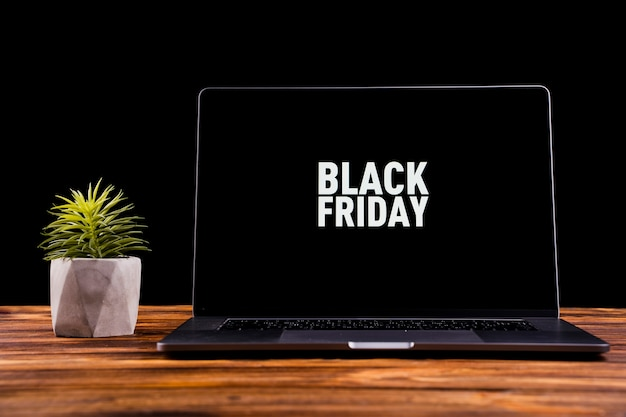 Laptop with black friday message on desktop Free Photo