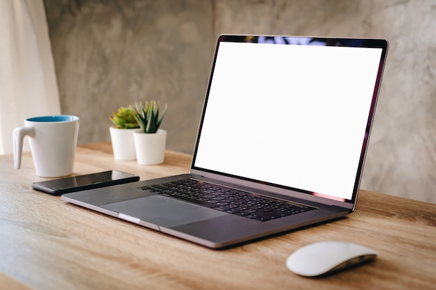 Laptop with blank screen on table Premium Photo