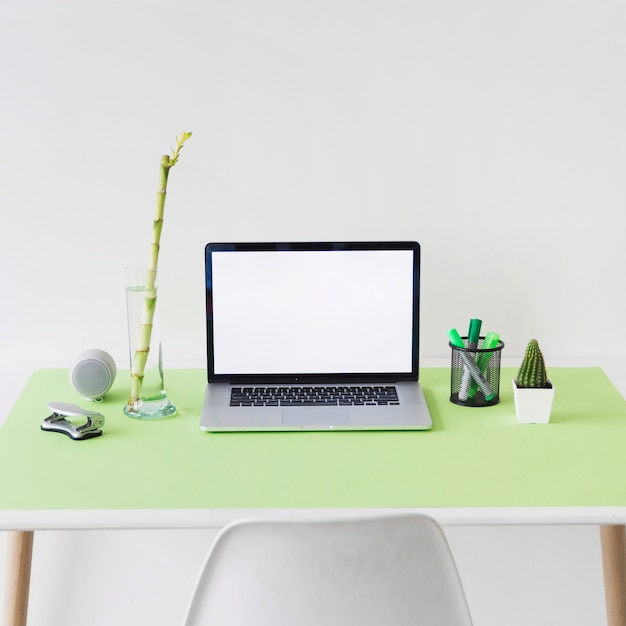 Laptop with blank white screen on office desk Free Photo