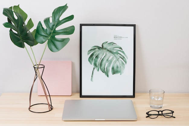 Laptop with picture and glasses on table Free Photo