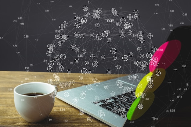 Laptop on wooden desk with social media diagram Free Photo