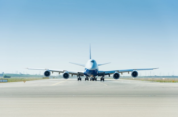 Large airplane on the runway ready for takeoff Premium Photo
